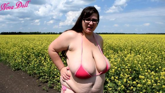 fun outdoors BBW MILF flowers bikini