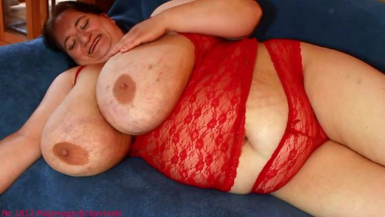 Sunniva's Huge Breasts in a Red Lingerie