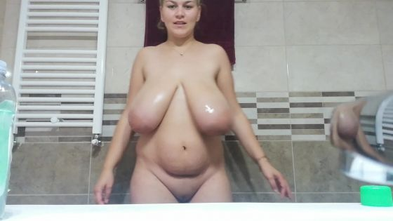 Oily playing with my boobs in my bathroom