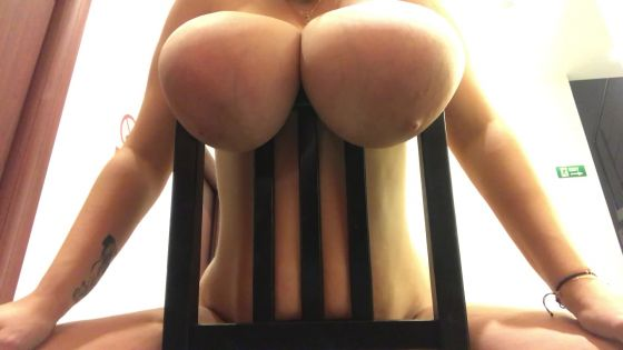 Huge boobs freely hanging on chair