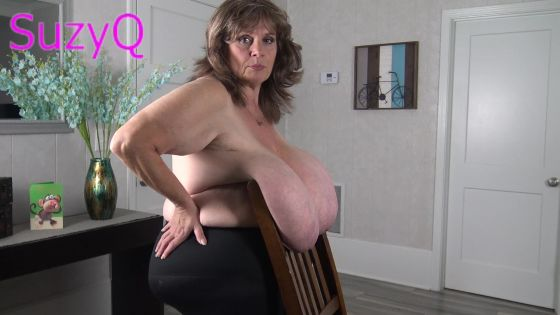 Suzie Carries A Chair with Her Breasts